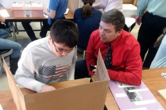 A student demonstrates his project.