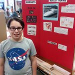 Photo of a student proud of his project.