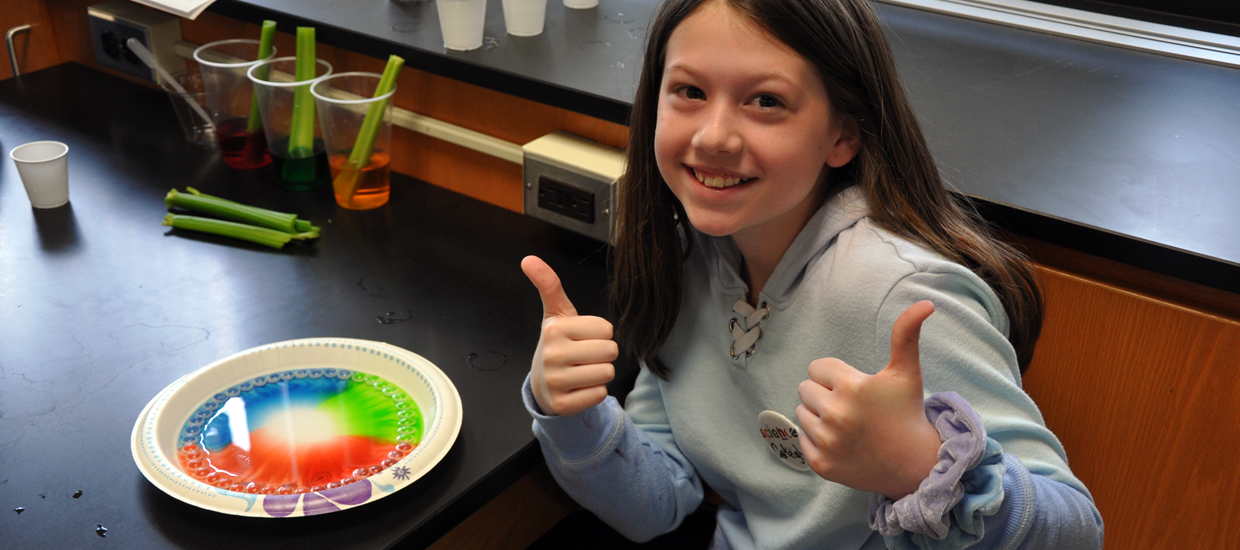 A student gives two thumbs up.