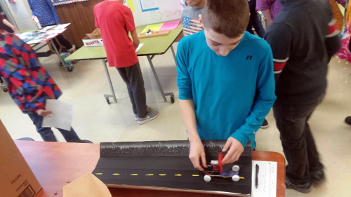 A young inventor prepares his project for a demonstration.