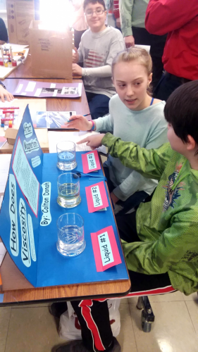 Young inventors discussing a project.
